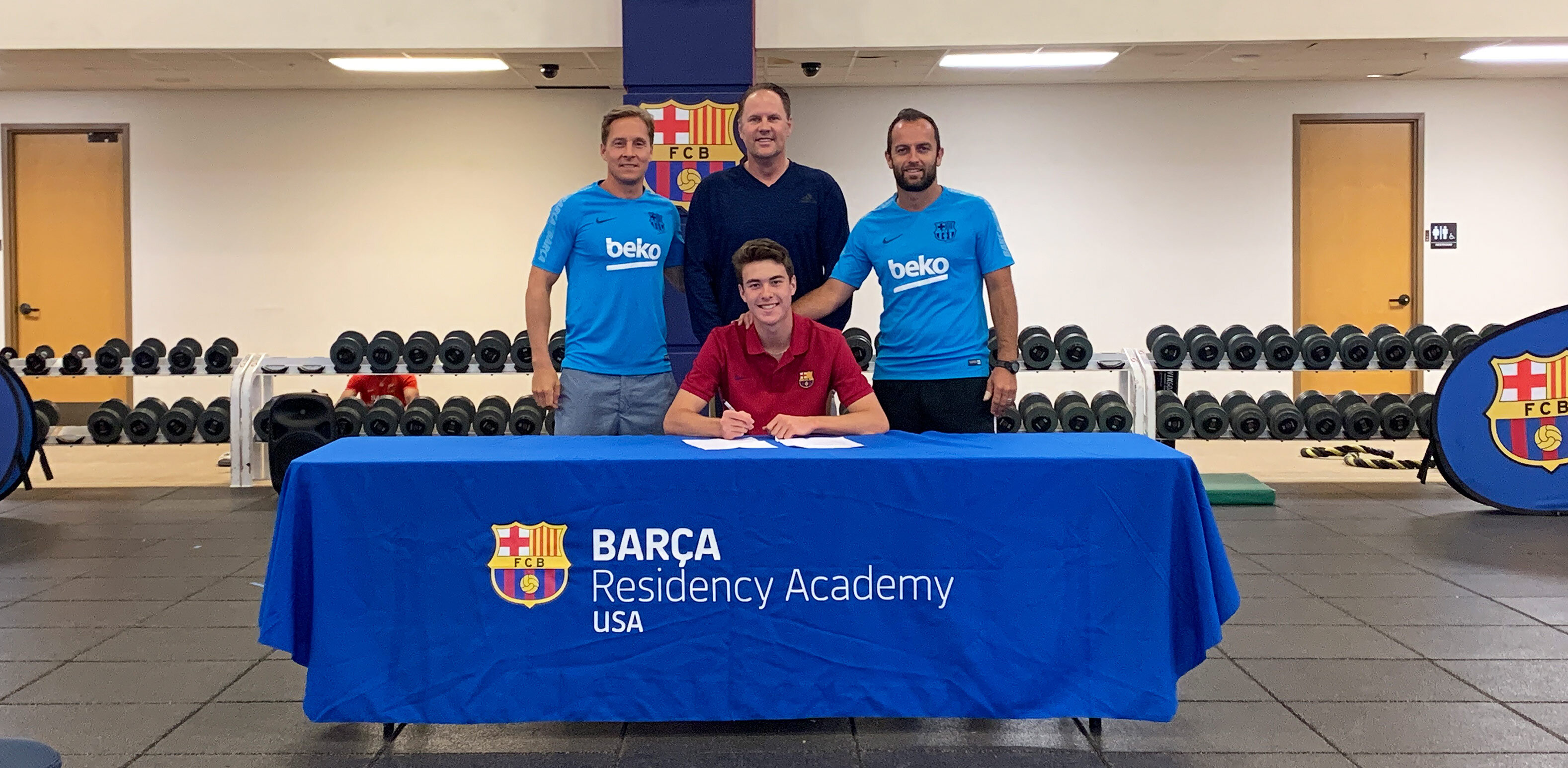 Barca Residency Academy's Matthew Hoppe signing his first professional contract with Matthew Hoppe. (left to right) Miha Kline, Tom Hoppe, Matthew Hoppe and Sean McCafferty.