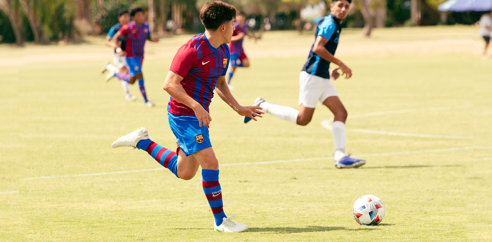 Barca Residency Academy player Yahir Gonzalez driving the ball up the field